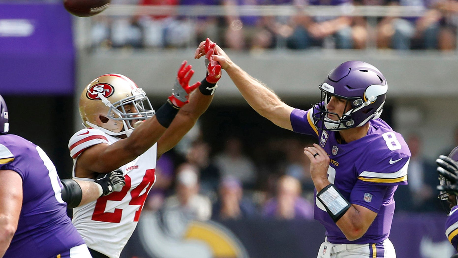 Minnesota Vikings quarterback Kirk Cousins (8) throws a pass over San Francisco 49ers defensive back K'Waun Williams (24) during the first half of an NFL football game, Sunday, Sept. 9, 2018, in Minneapolis. (AP Photo/Bruce Kluckhohn)