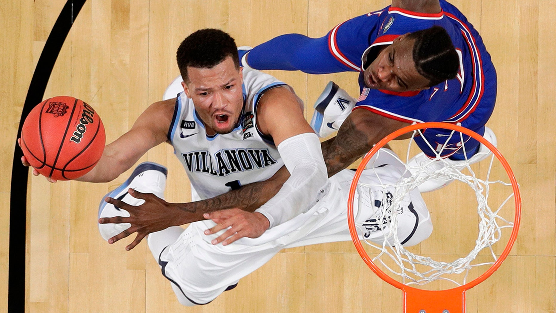 Villanova's Jalen Brunson (1) shoots over Kansas's Lagerald Vick (2) during the second half in the semifinals of the Final Four NCAA college basketball tournament, Saturday, March 31, 2018, in San Antonio.