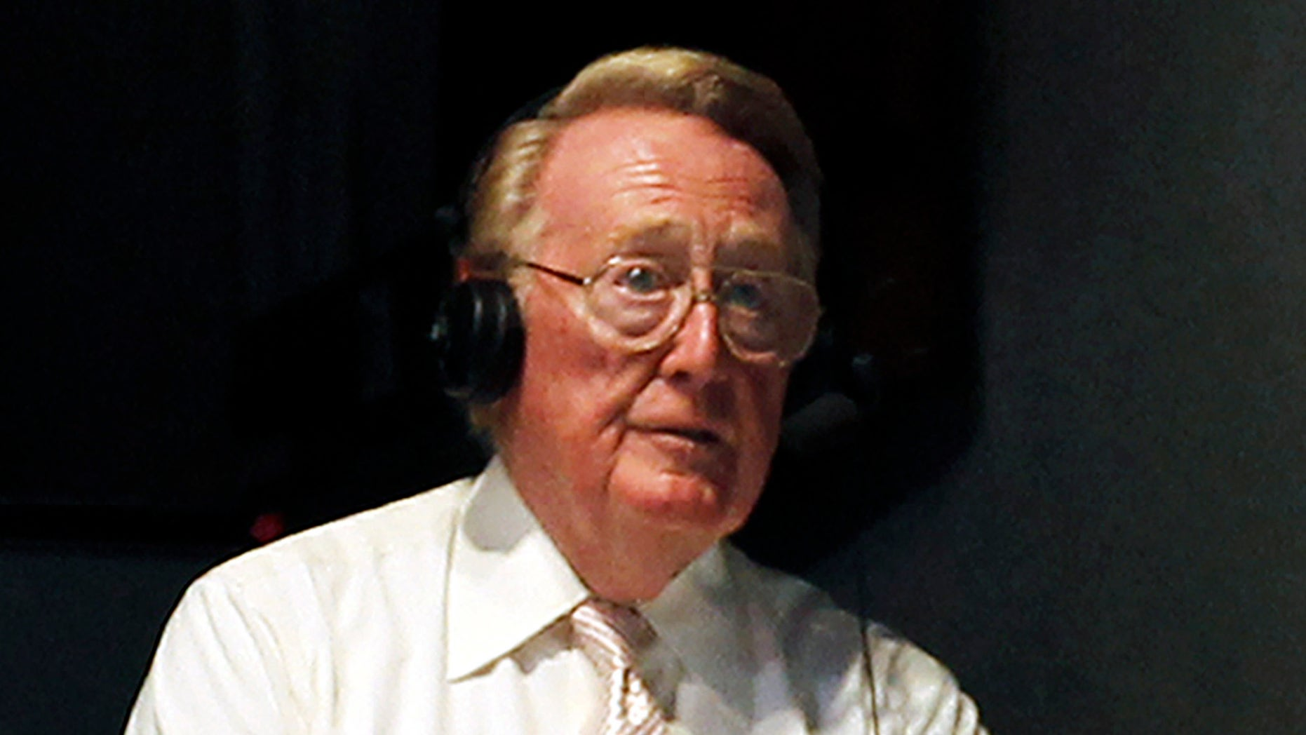 July 8, 2011: Los Angeles Dodgers sportscaster Vin Scully works in the press box as the New York Mets play against the Los Angeles Dodgers