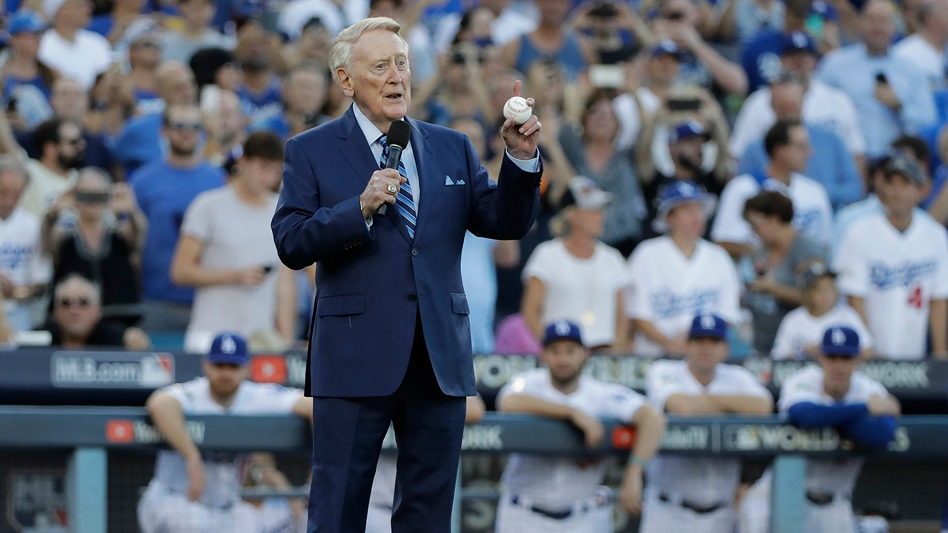 Vin Scully helps throw out the ceremonial first pitch before Game 2 of baseball's World Series between the Houston Astros and the Los Angeles Dodgers Wednesday, Oct. 25, 2017, in Los Angeles.