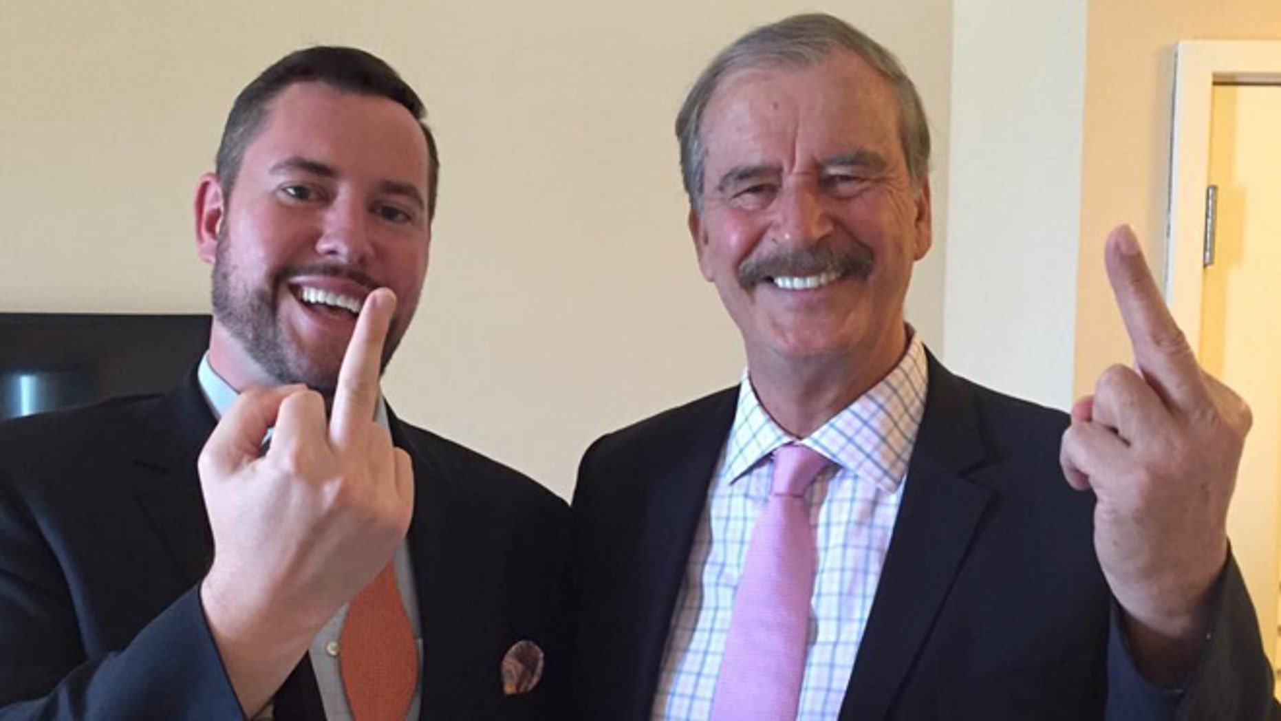 Former Mexican President Vicente Fox (right) makes an obscene gesture to Donald Trump after appearing on the Kickass Politics podcast with host Ben Mathis.