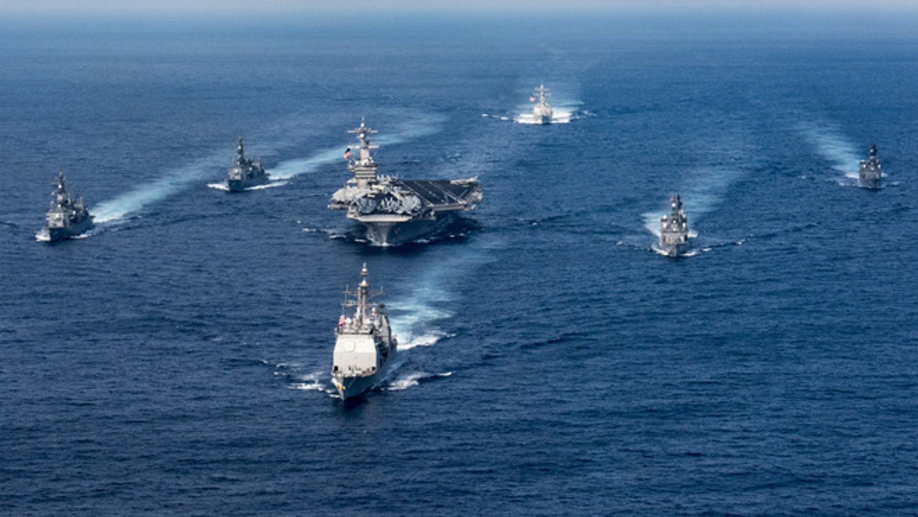 The USS Carl Vinson (CVN 70), the guided-missile destroyer USS Wayne E. Meyer (DDG 108) and the guided-missile cruiser USS Lake Champlain (CG 57) on deployment to the Western Pacific.