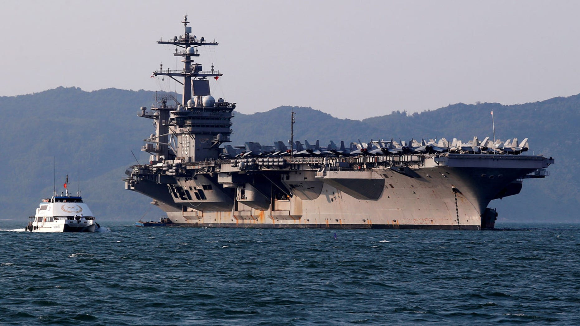 March 5: U.S. Navy aircraft carrier, USS Carl Vinson, docks at a port in Danang, Vietnam