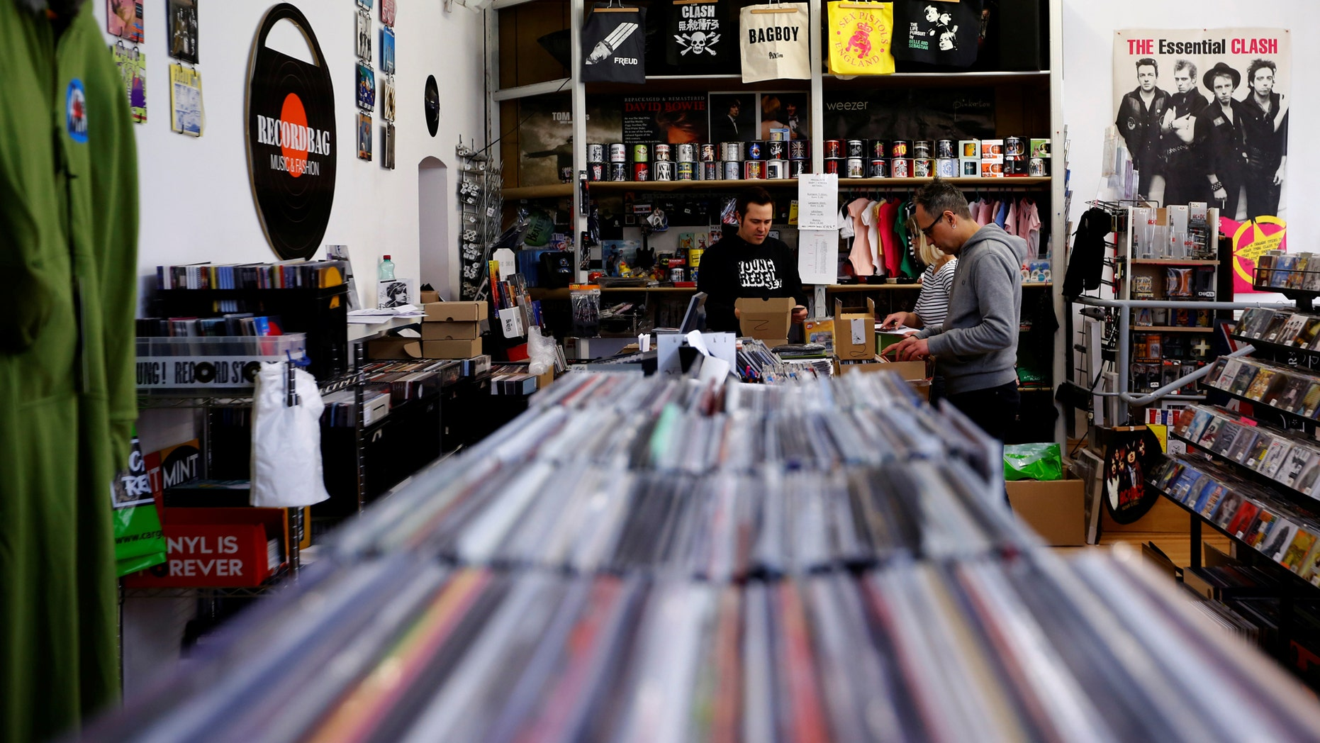 File photo: Employees check vinyl albums in the Recordbag shop ahead of the International Record Store day in Vienna, Austria, April 21, 2017. (REUTERS/Leonhard Foeger)