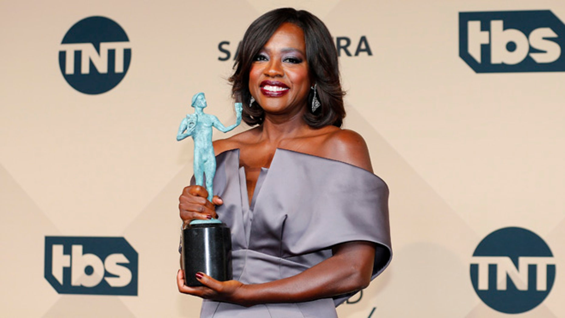 """January 30, 2016. Viola Davis holds the award for Outstanding Performance by a Female Actor in a Drama Series for her role in """"How to Get Away With Murder"""" during the 22nd Screen Actors Guild Awards in Los Angeles."""