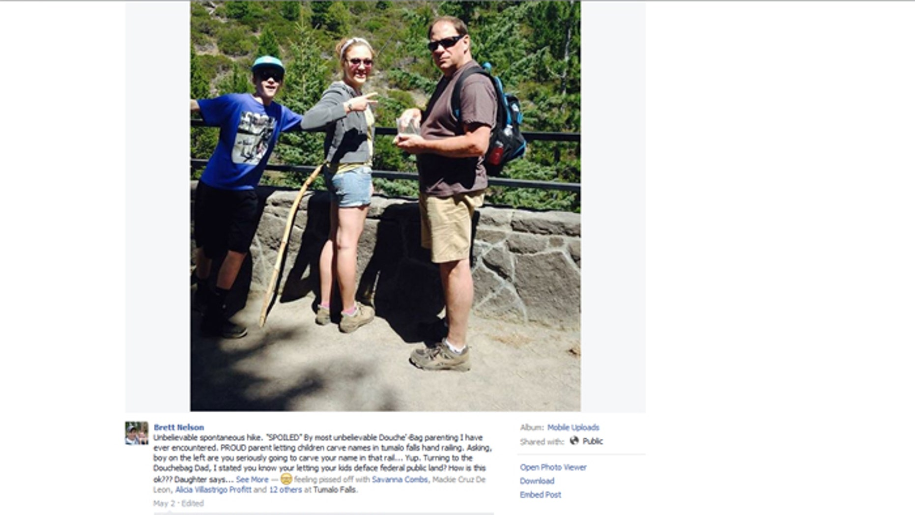 An angry hiker posted this photo online after allegedly seeing the subjects carving initials into a railing.