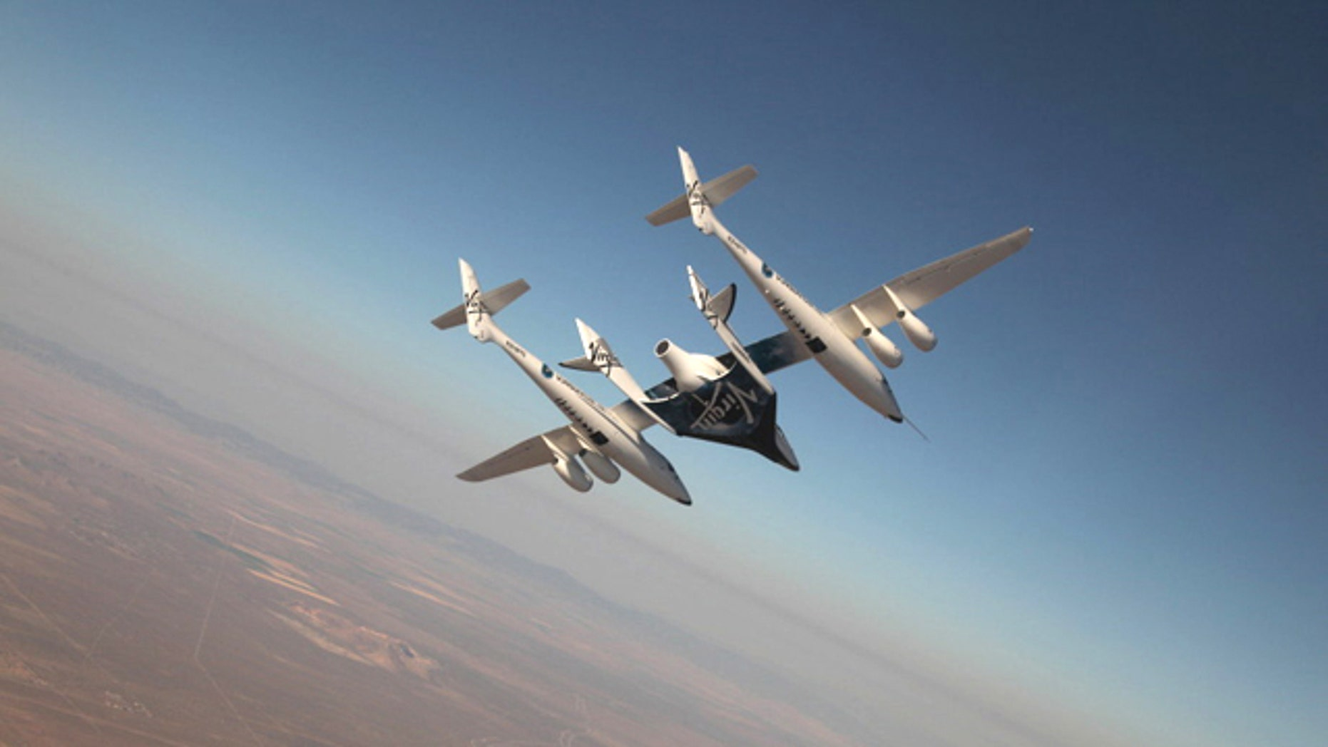 The Virgin Galactic suborbital spaceliner SpaceShipTwo makes its first crewed flight on July 15, 2010 over the Mojave Desert in California, one of a series of test flights before the first free flight of the passenger ship for space tourism flights.