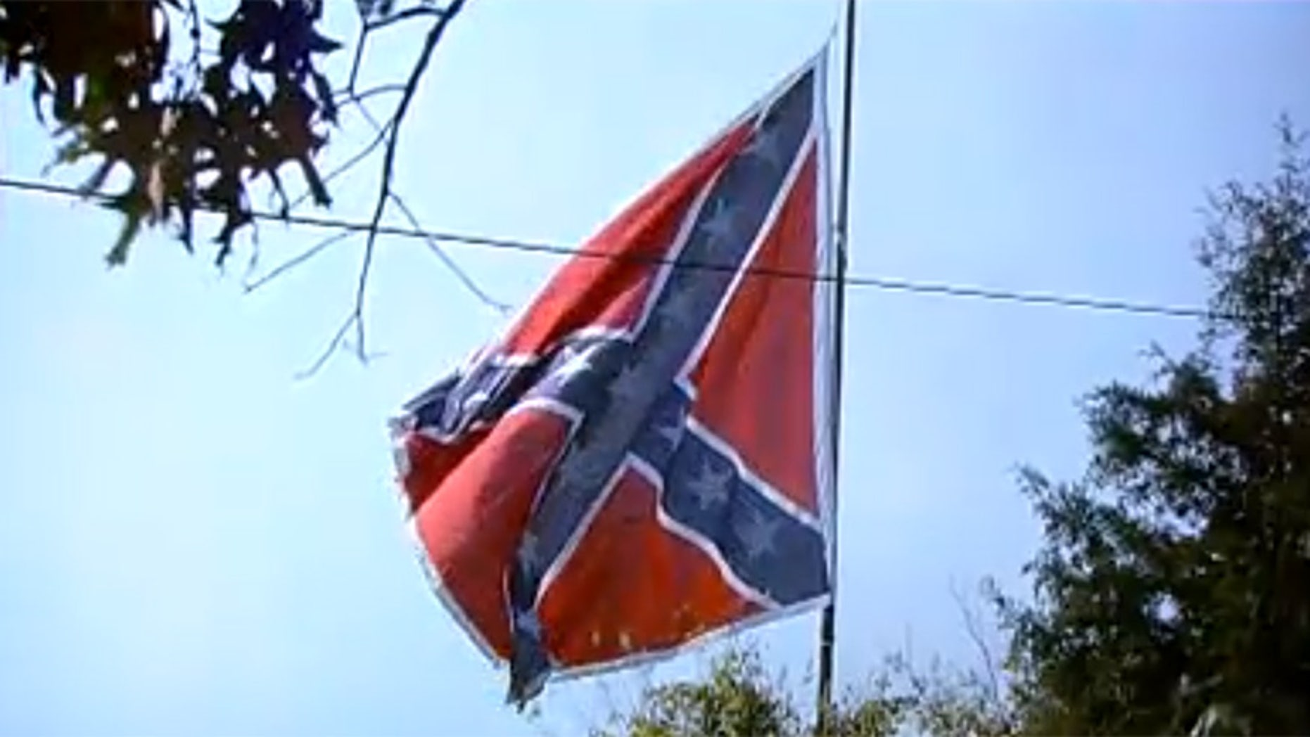 Confederate flags in Fredericksburg, Virginia can be seen from Interstate 95 and a woman got a permit to erect a Black Lives Matter flag just as large.