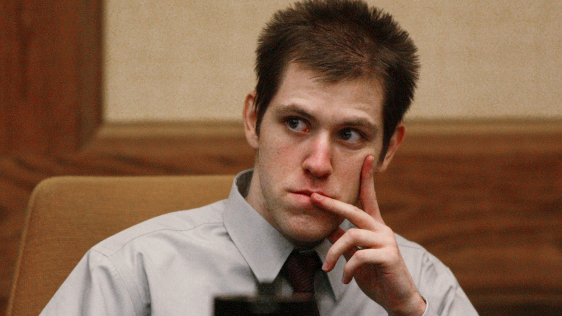 In this Thursday March 29, 2007, file photo, William Morva watches as prospective jury members are interviewed to serve in his attempted robbery trial in Montgomery County Circuit Court in Christiansburg, Va.