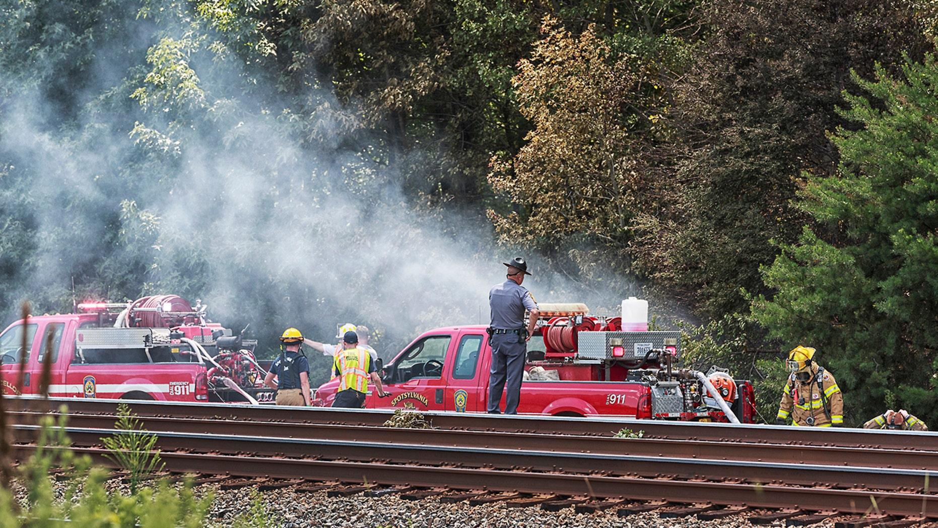 Aug. 12, 2016: Emergency personnel investigate the scene of a plane crash near Shannon Airport in Fredericksburg, Va.