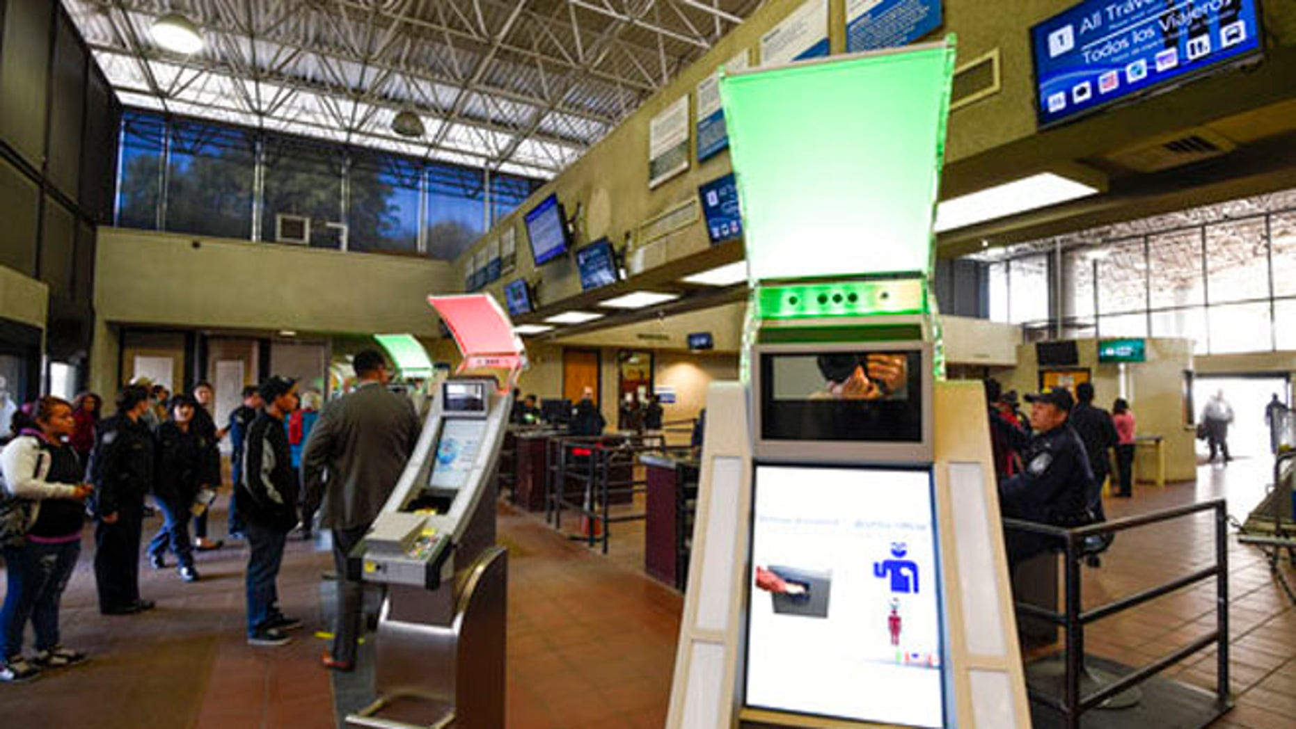 Dec. 10, 2015: Pedestrians crossing from Mexico into the United States at the Otay Mesa Port of Entry wait to use biometric kiosks in San Diego