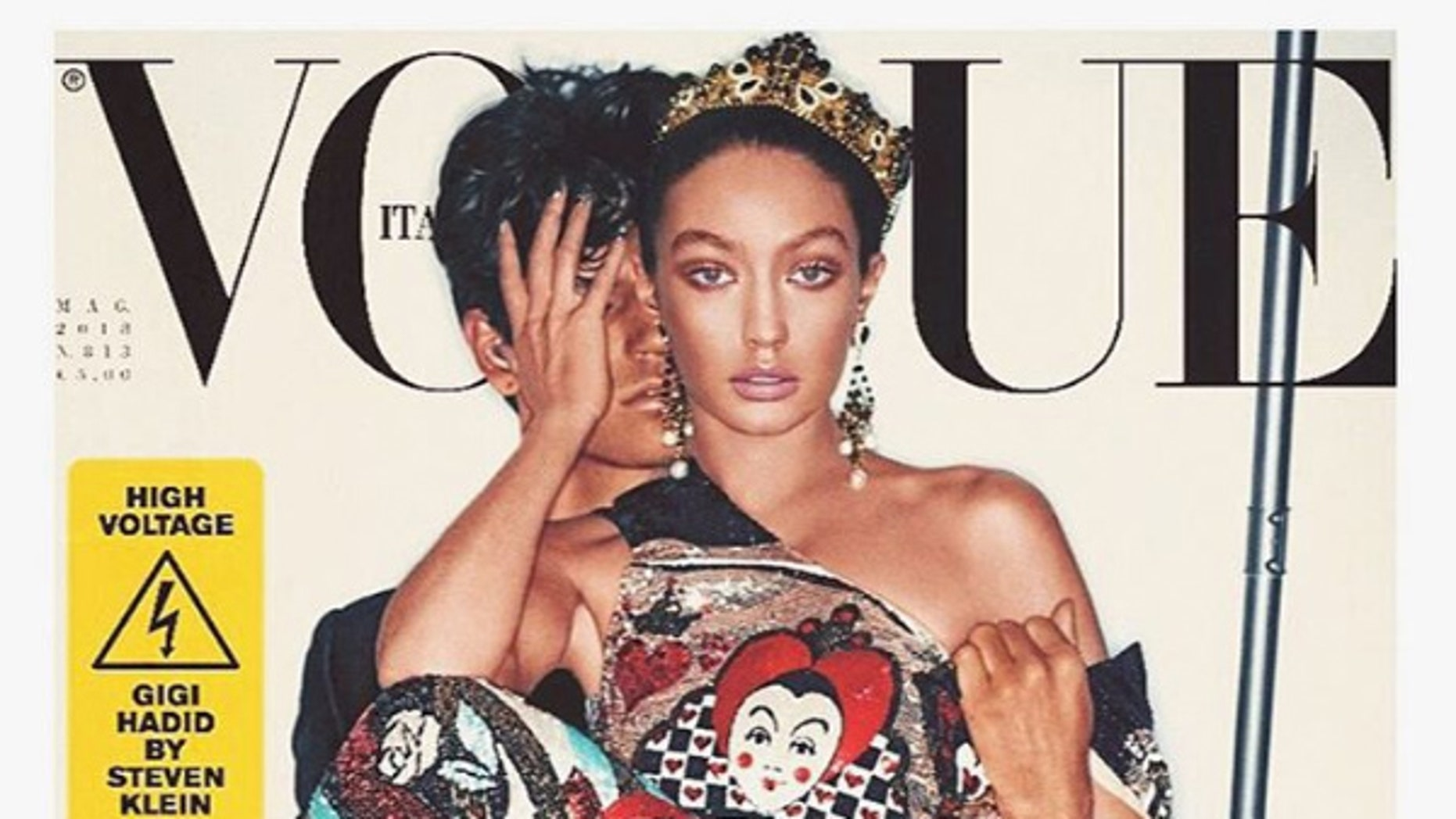 Gigi Hadid appears on the cover of Vogue Italia. Some are criticizing the magazine for seemingly darkening her skin.