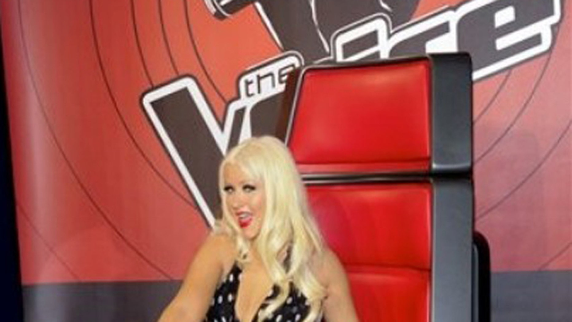 """Singer Christina Aguilera, from """"The Voice"""", attends the NBC Network Upfront on Monday, May 16, 2011 in New York."""
