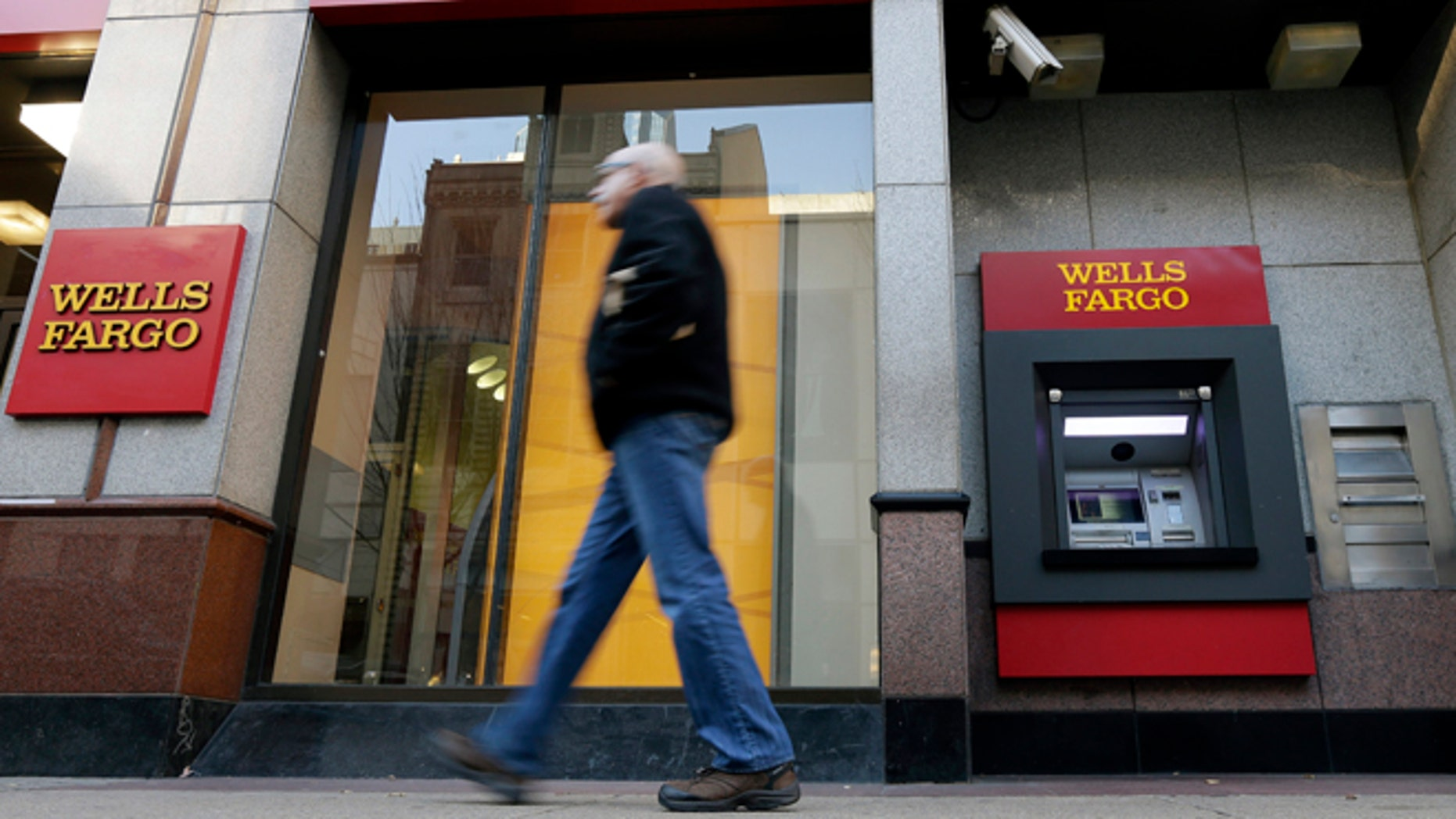 Dec. 19, 2012: A man walks past a Wells Fargo branch in Philadelphia.