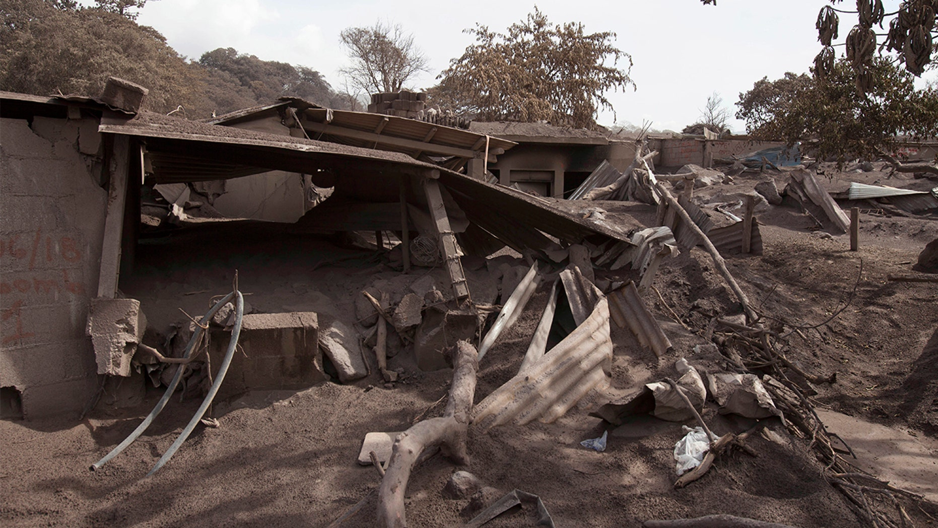 "Volcanic ash blankets a home destroyed by the Volcan de Fuego, or ""Volcano of Fire,"" eruption, in Escuintla, Guatemala."