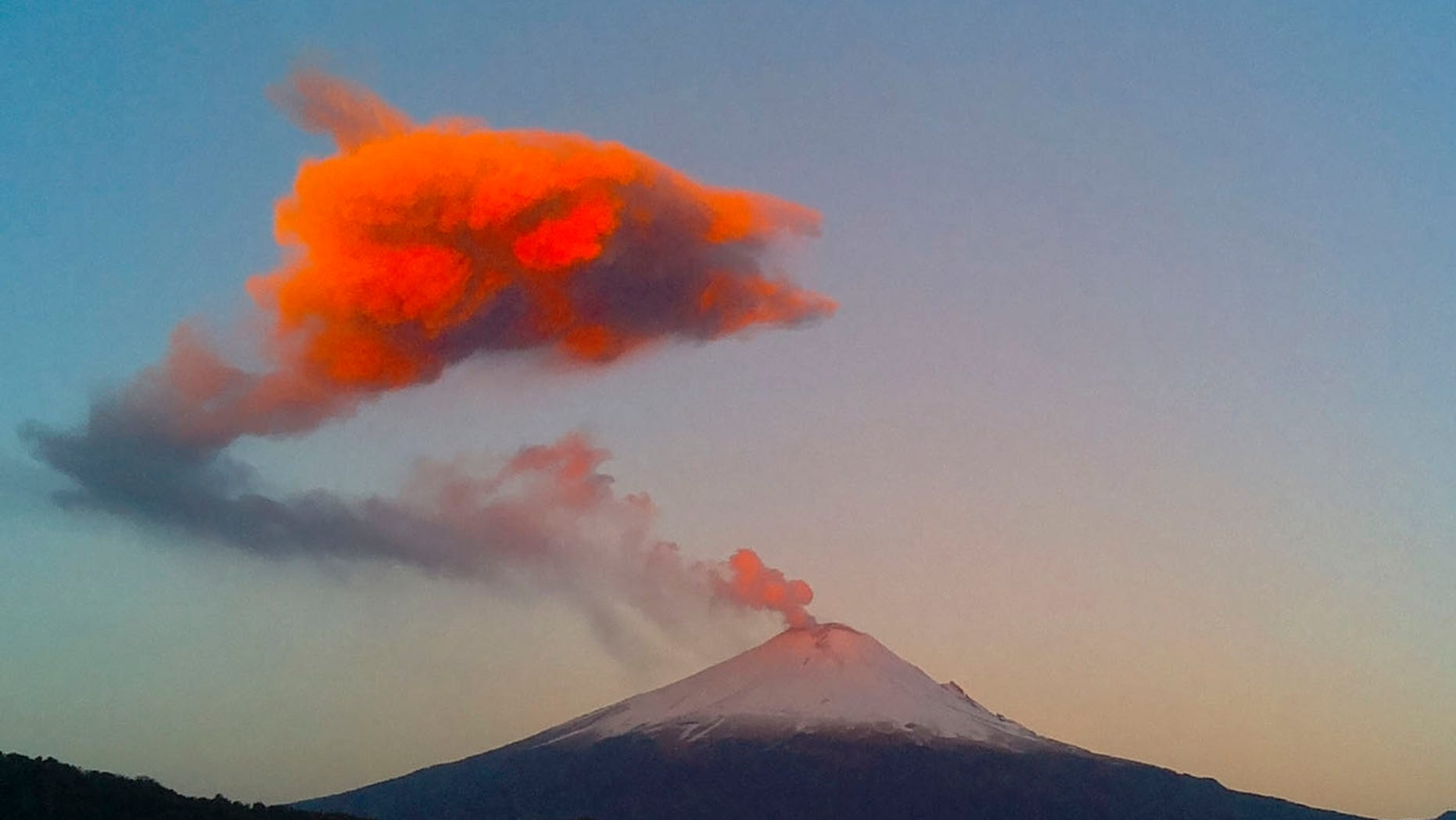 This March 25, 2015 file photo shows a plume of ash and steam rising from the crater of the Popocatepetl volcano, seen from the town of San Nicolas de los Ranchos, Mexico.