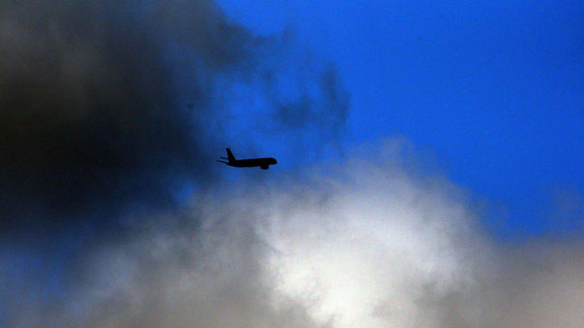 April 20: A Jet2.com Boeing 757 flies through the clouds leaving Newcastle International Airport, England. (AP)