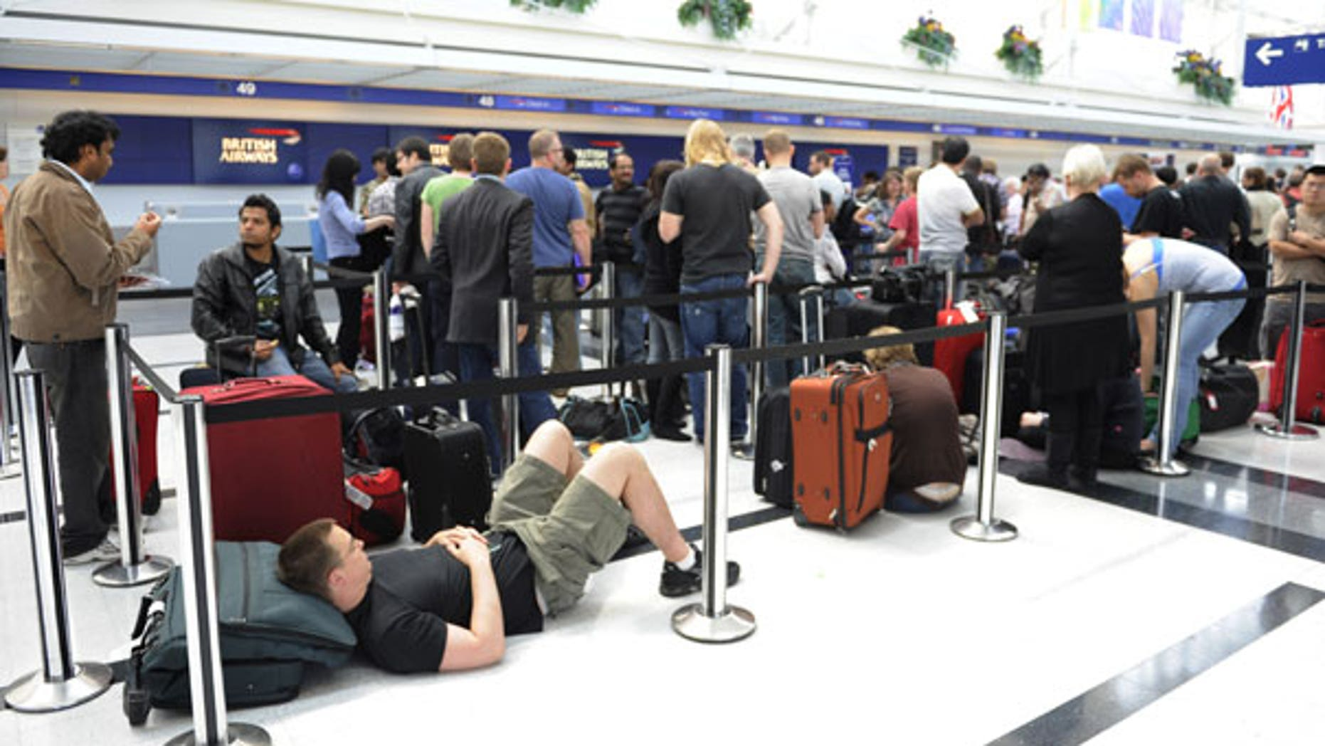 April 15: People wait in line at British Airways to try and catch flights to Europe at O'Hare International Airport in Chicago. (AP)