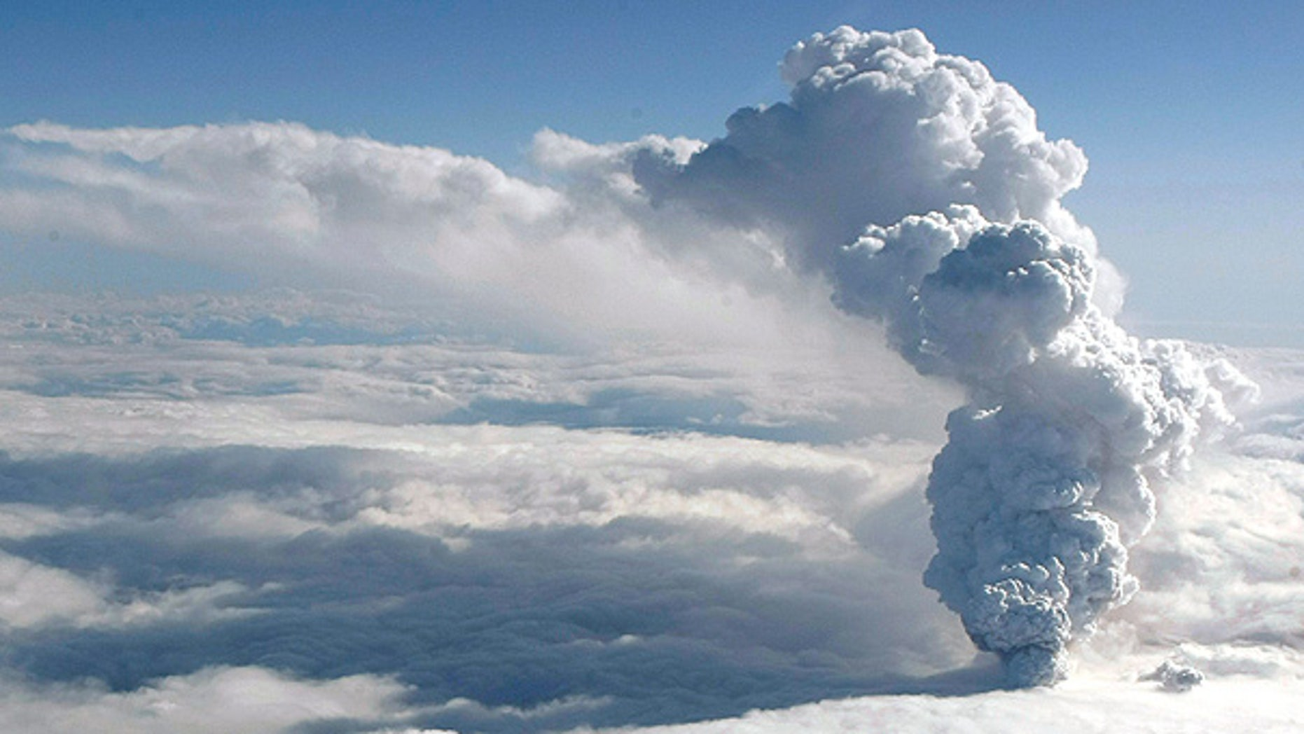 April 14: Smoke and steam rises from the volcano under the Eyjafjallajokull glacier in Iceland.