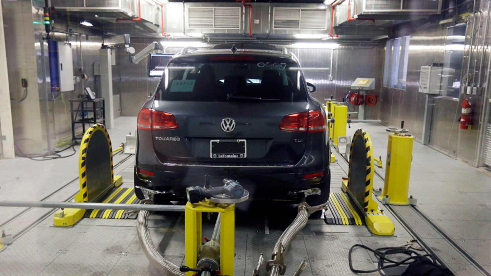 FILE - In this Oct. 13, 2015, file photo, a Volkswagen Touareg diesel is tested in the Environmental Protection Agency's cold temperature test facility in Ann Arbor, Mich. The imminent criminal plea deal between Volkswagen and U.S. prosecutors in an emissions-cheating scandal could be bad news for one group of people: VW employees who had a role in the deceit or subsequent cover-up. VW on Tuesday, Jan. 10, 2017, disclosed that it is in advanced talks to settle the criminal case by pleading guilty to unspecified charges and paying $4.3 billion in criminal and civil fines, a sum far larger than any recent case involving the auto industry. (AP Photo/Carlos Osorio, File)