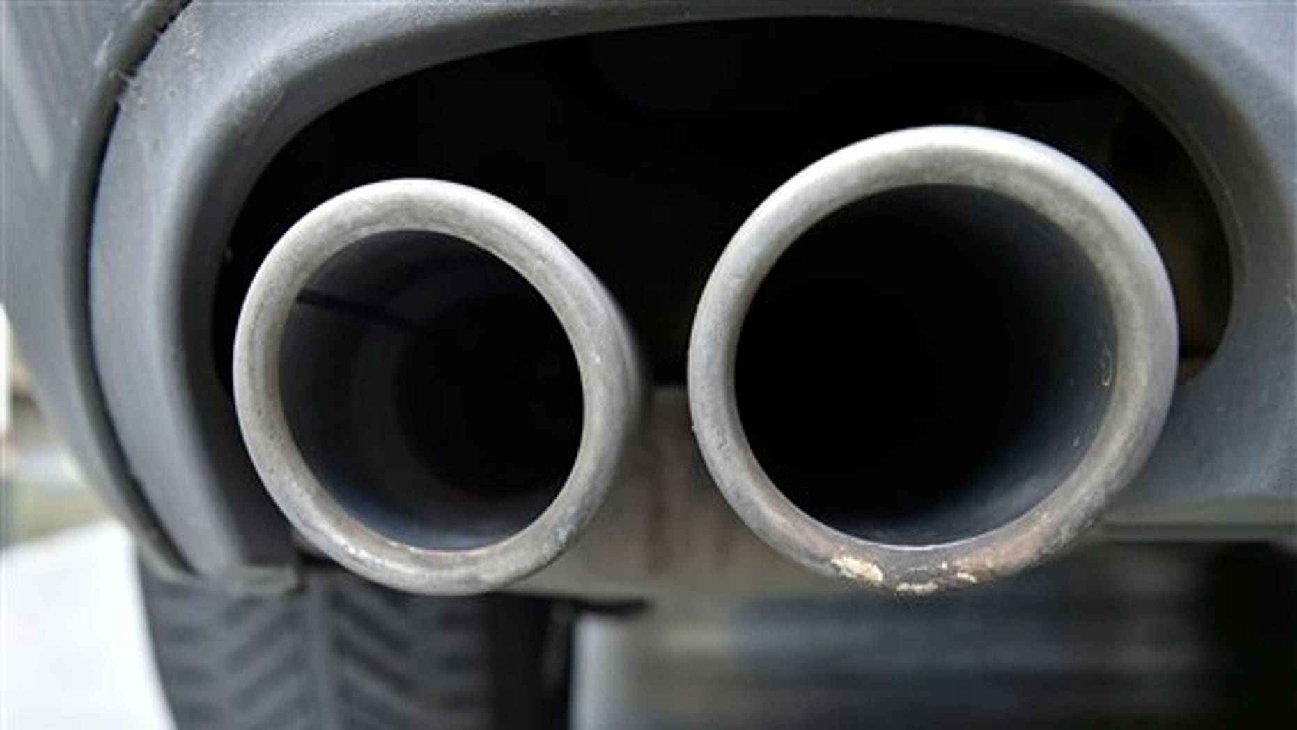 """The exhaust pipes of an up to date Audi car blow out not visible emissions during the engine start in Gelsenkirchen, Germany, Wednesday, Nov. 4, 2015. Volkswagen said Tuesday that an internal investigation has revealed """"unexplained inconsistencies"""" in the carbon dioxide emissions from 800,000 of its vehicles. (AP Photo/Martin Meissner)"""