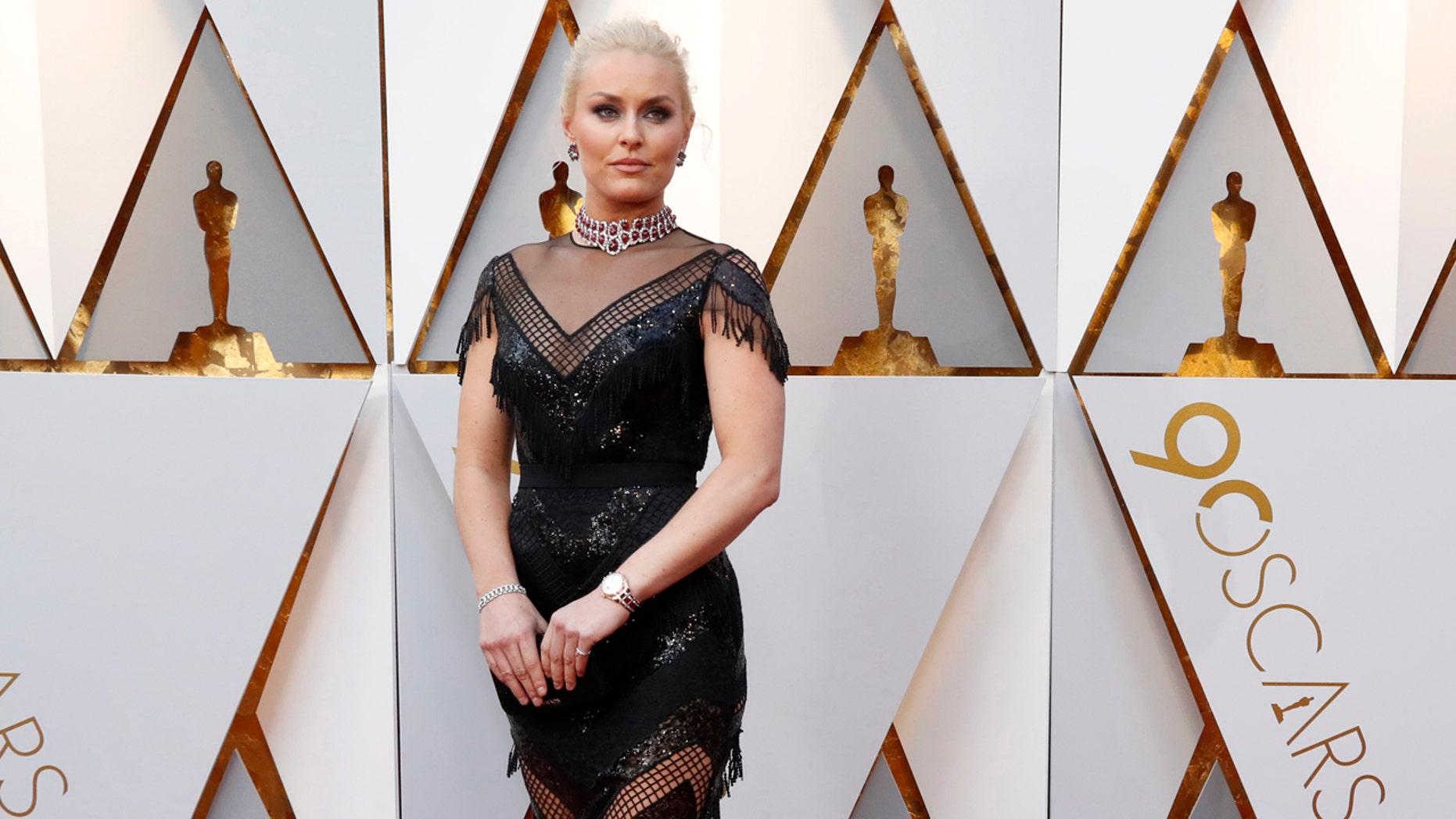 Skier Lindsey Vonn wears Christian Siriano on the Oscars red carpet.
