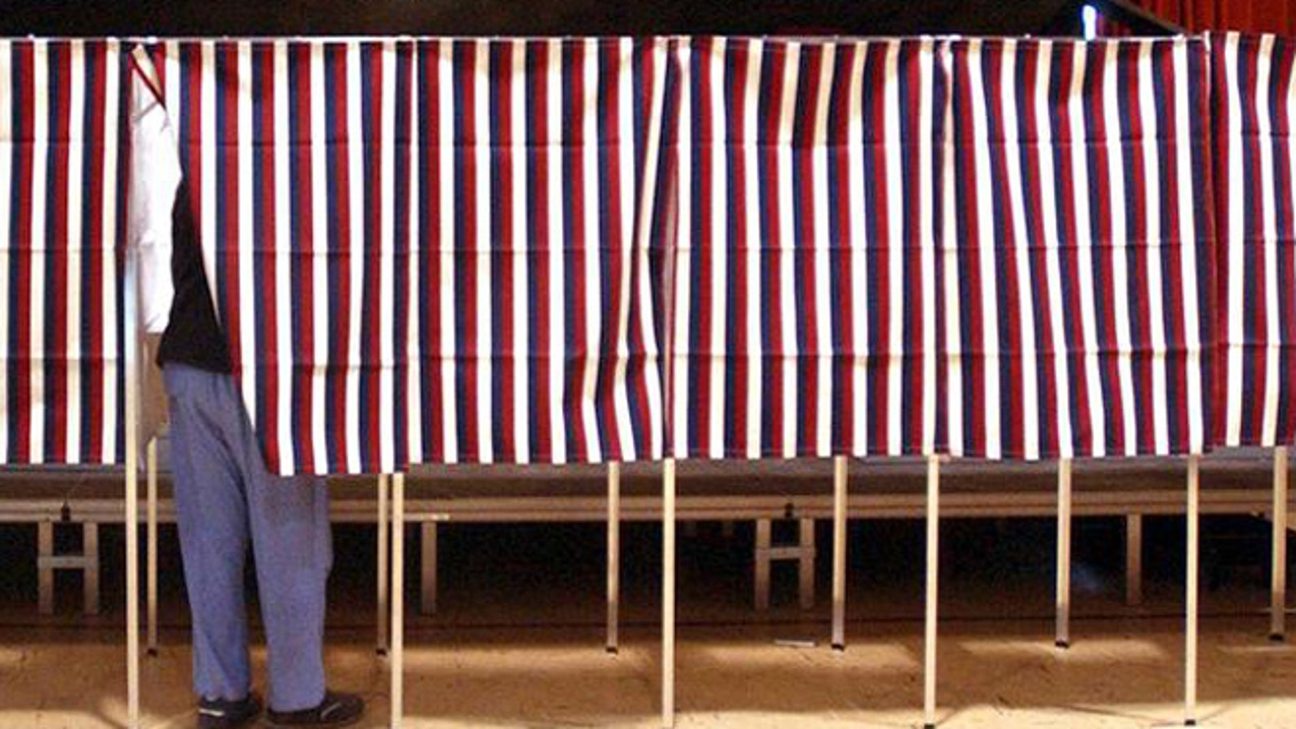 FILE: Feb. 2004: Voter in voting booth during Super Tuesday primary, Montpellier, Vt.