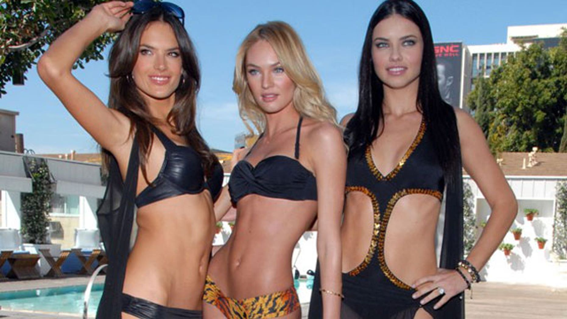 Victoria's Secret Models Alessandra Ambrosio, Candice Swanepoel and Adriana Lima.