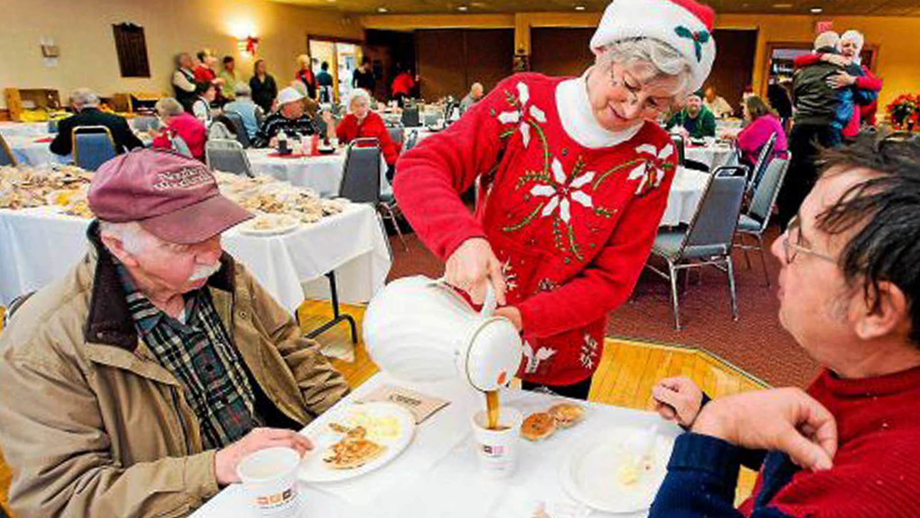 Dec. 2011: Connie Howe pours coffee for Ronald Read, left, and Dave Smith during the Charlie Slate Memorial Christmas breakfast at the American Legion.