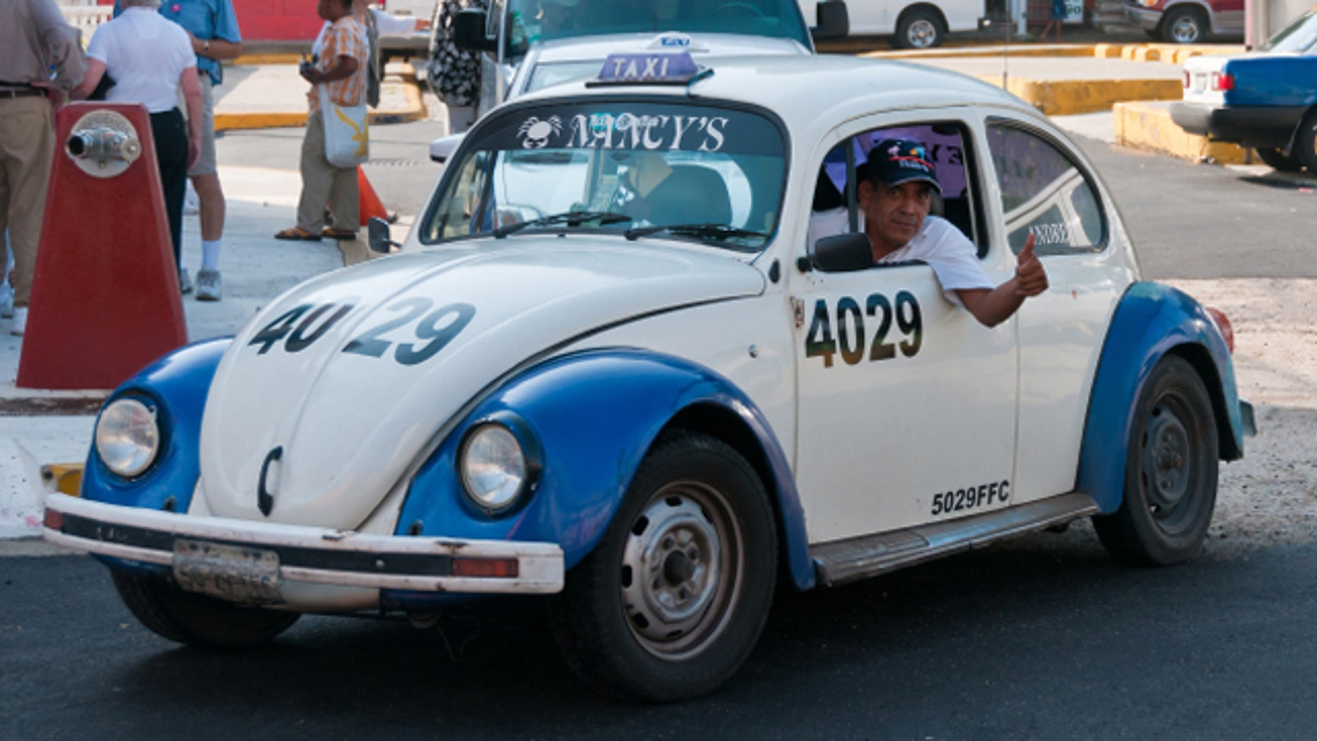 VW Beetle Taxi on the streets of Acapulco, Mexico