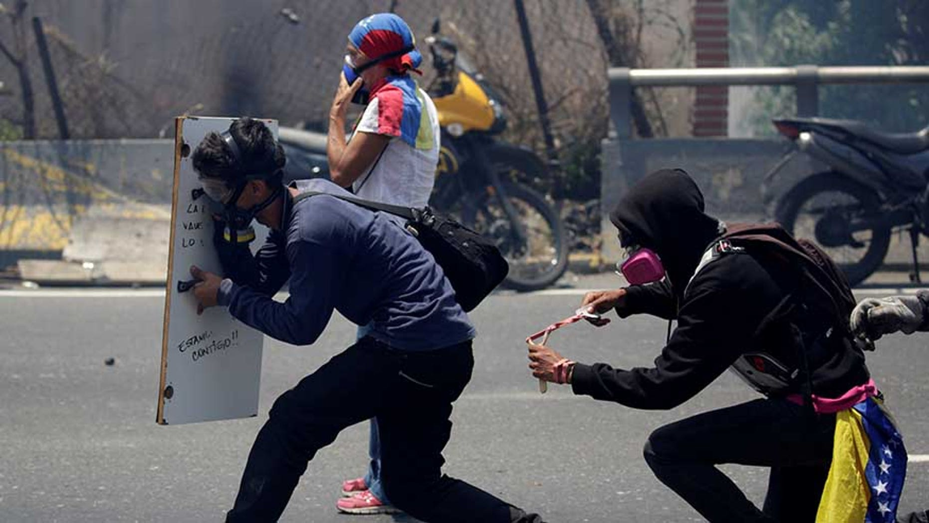 Opposition supporters clash with security forces during a rally in Caracas, Venezuela, April 26, 2017.