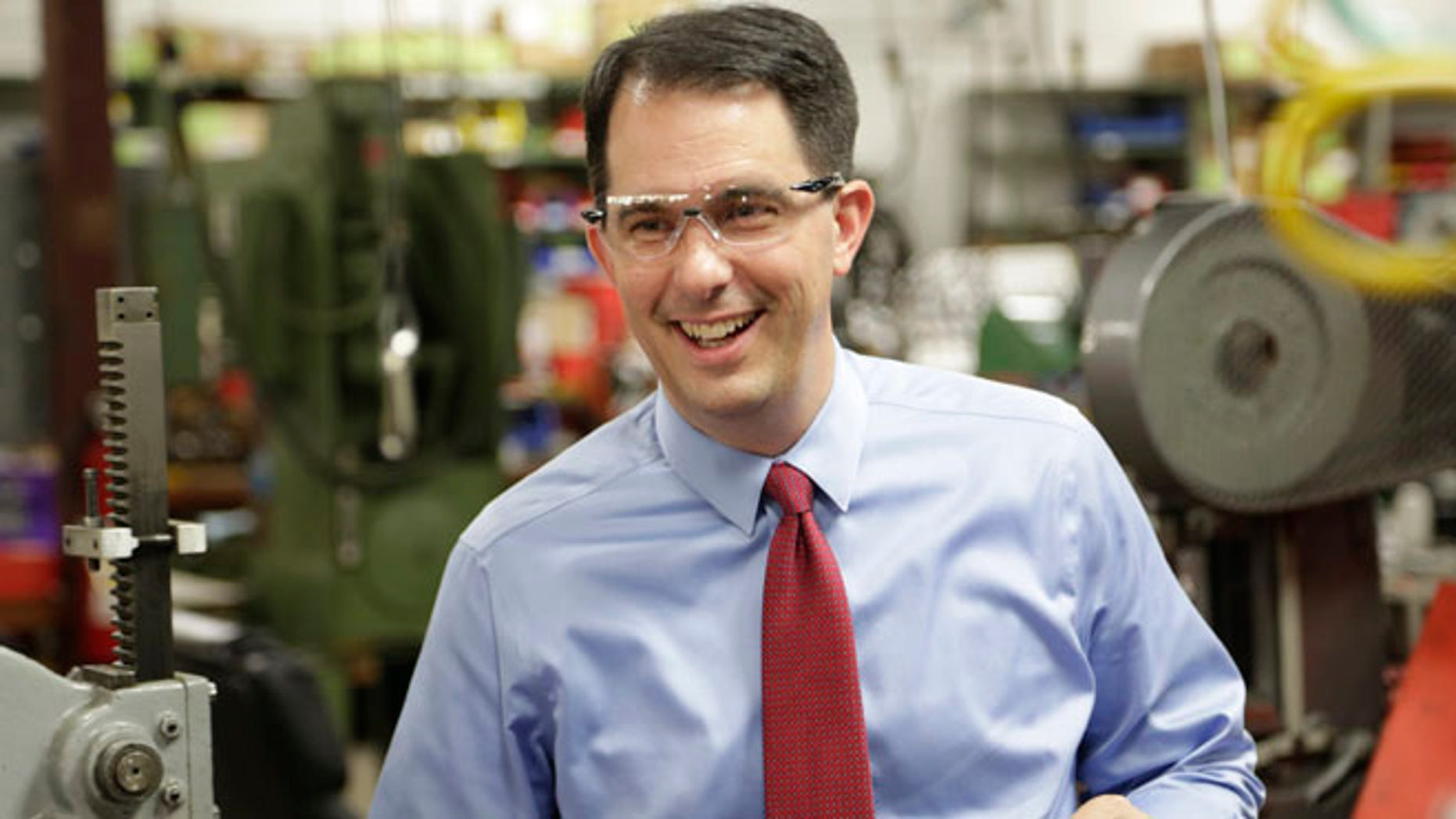 Sept. 23, 2014: Wisconsin Repubican Gov. Scott Walker makes a re-election campaign stop at a small business in Racine, Wis.