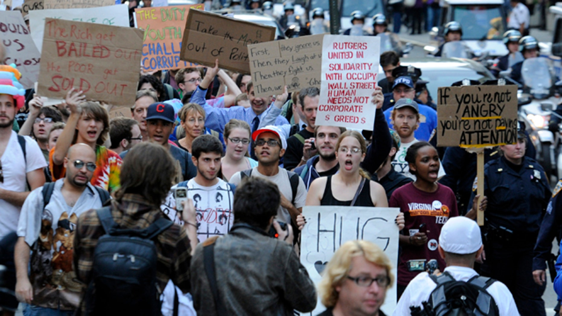 Oct. 8: Occupy Wall Street demonstrators walk down Broadway from Washington Square Park to Zuccotti Park in New York.