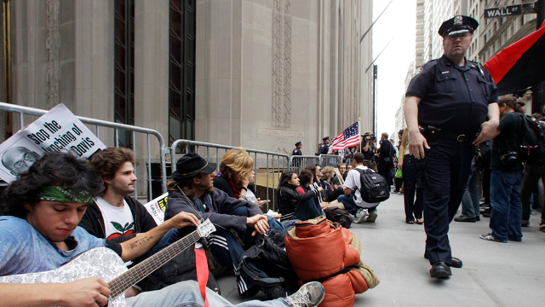 Sept. 17: Demonstrators gather in front of a police barricade to call for the occupation of Wall Street in New York.