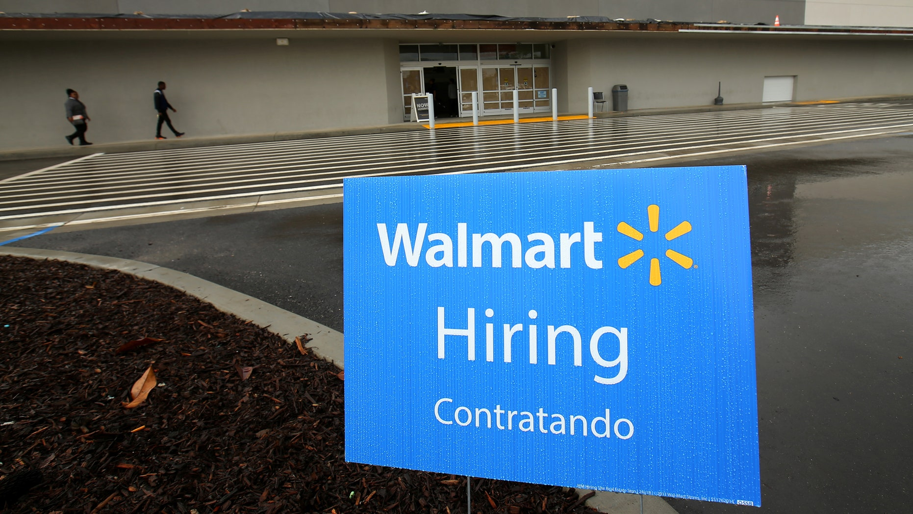 File photo: Job postings are shown outside a new Walmart Super Center as the company opens its first store in Compton, California, U.S., January 10, 2017. (REUTERS/Mike Blake)