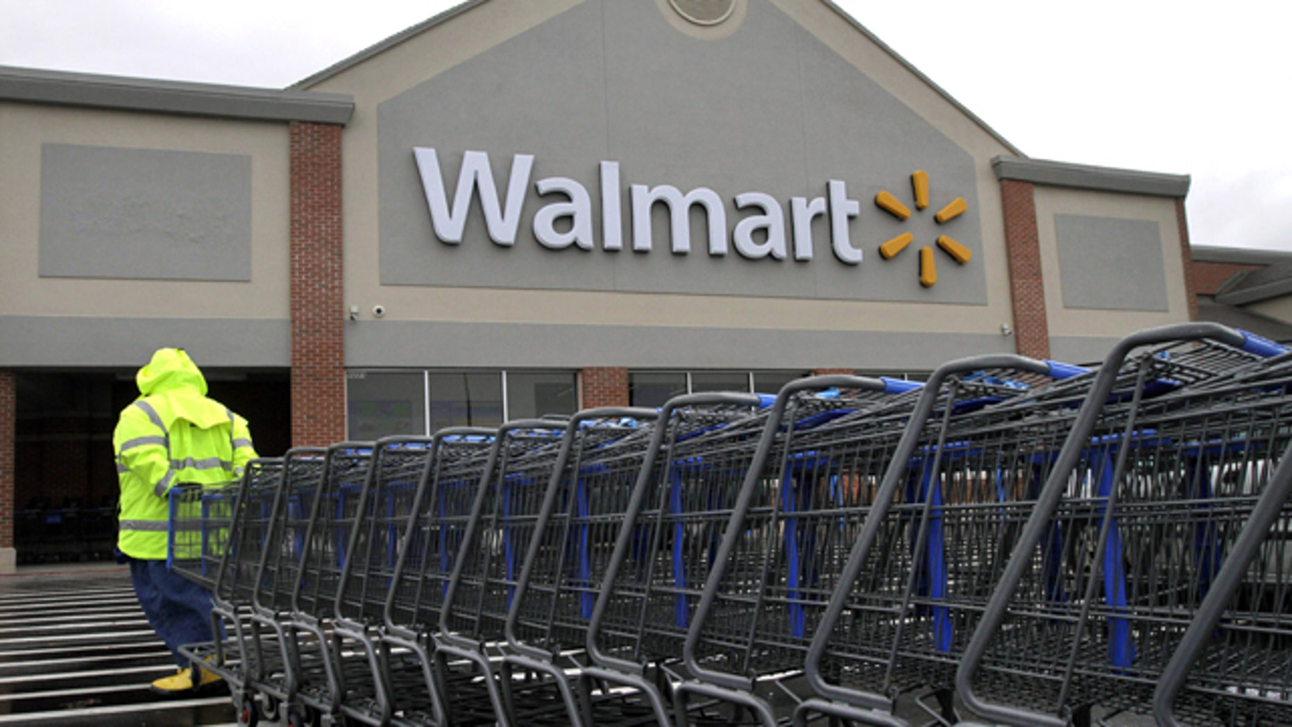 Nov. 13, 2012: A worker pulls a line of shopping carts toward a Walmart store in North Kingstown, R.I. (AP)