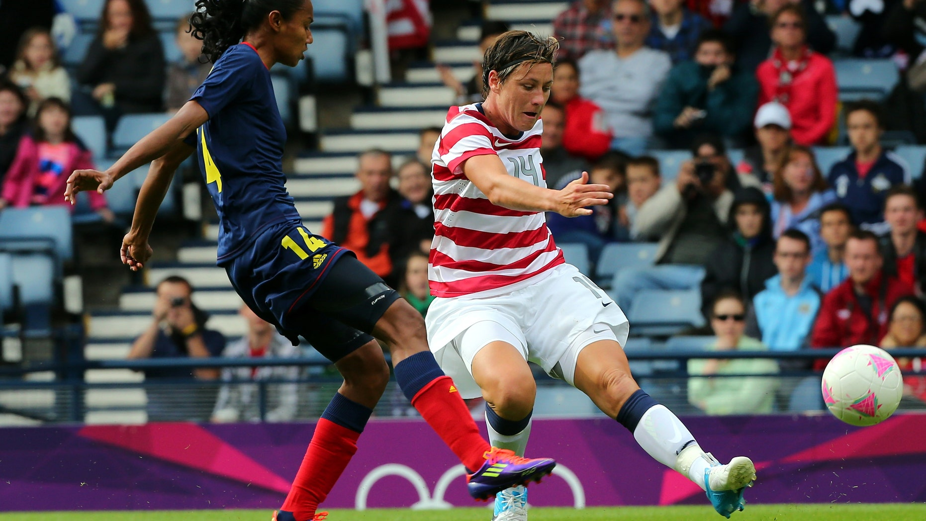 Abby Wambach of USA battles with Louisa Necib of Columbia during the Women's Football first round Group G match between United States and Colombia on Day 1 of the London 2012 Olympic Games at Hampden Park on July 28, 2012 in Glasgow, Scotland.  (Photo by Stanley Chou/Getty Images)