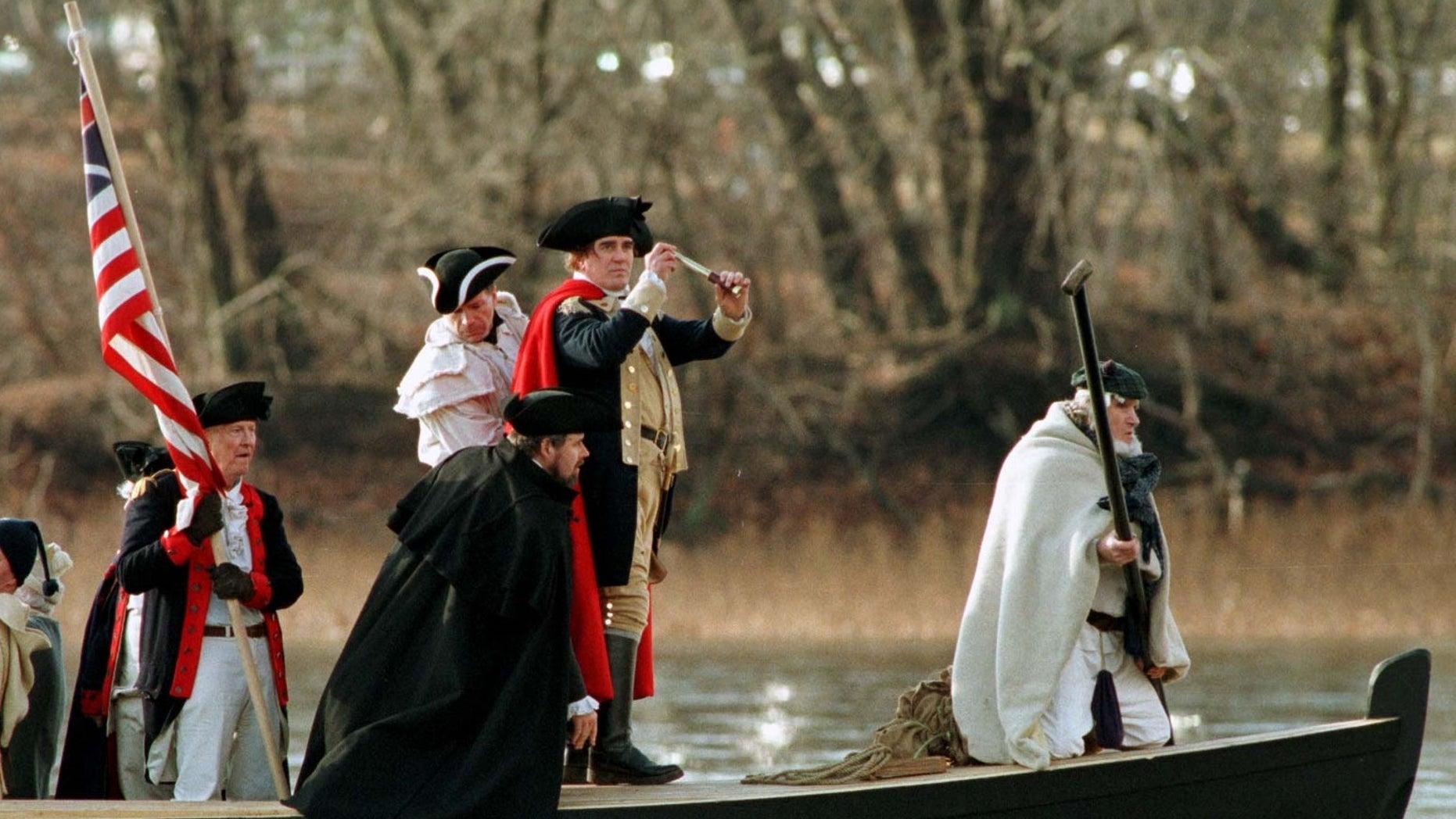 Revolutionary War reenactors cross the Delaware River between Pennsylvania and New Jersey.