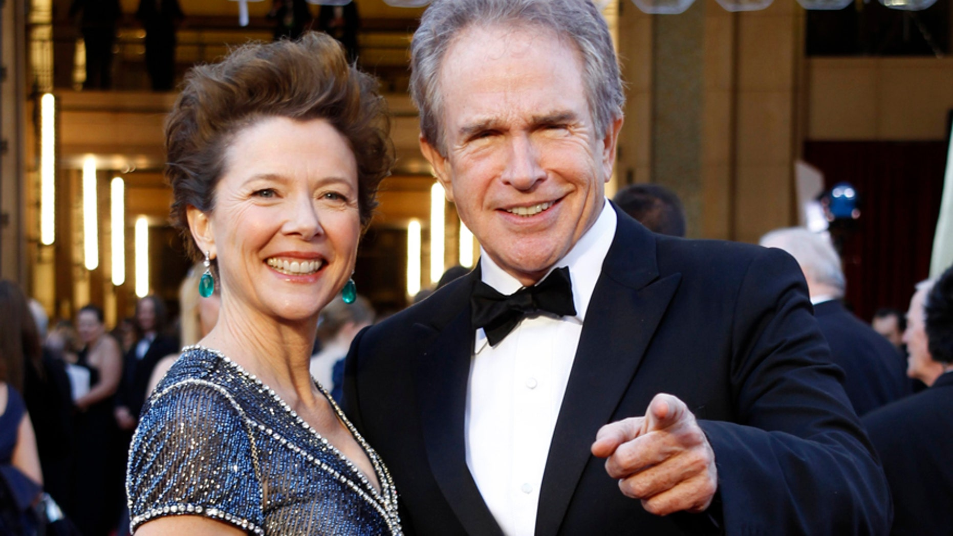 Annette Bening and husband Warren Beatty arrive at the 83rd Academy Awards in Hollywood, California, February 27, 2011.