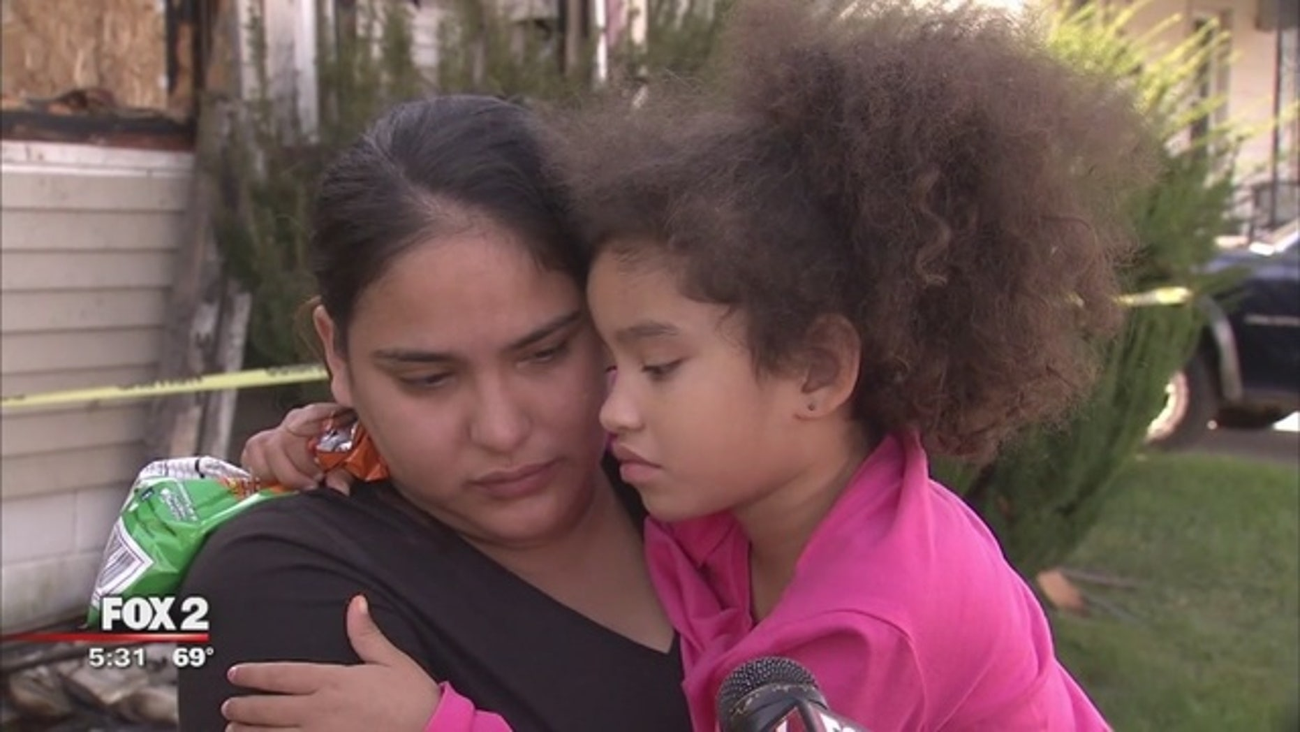 Rosa Conley with her daughter, Jamirah, who saved the family from a fire.