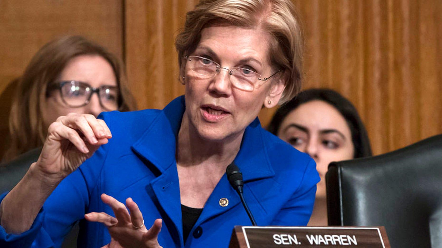 Sen. Elizabeth Warren joined with Sen. Brian Schultz, D-Hawaii, and Rep. Elijah Cummings, D-Md., to commission the GAO report.