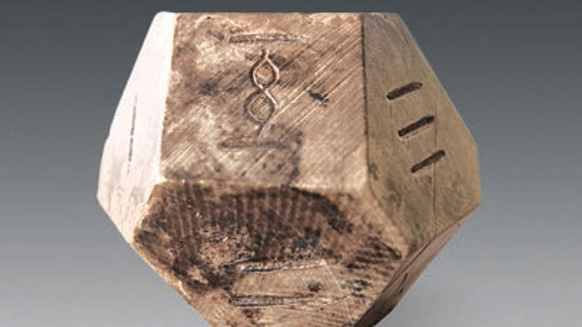 "Archaeologists think this 14-face die was used to play a game called ""bo"" that hasn't been played in 1,500 years."