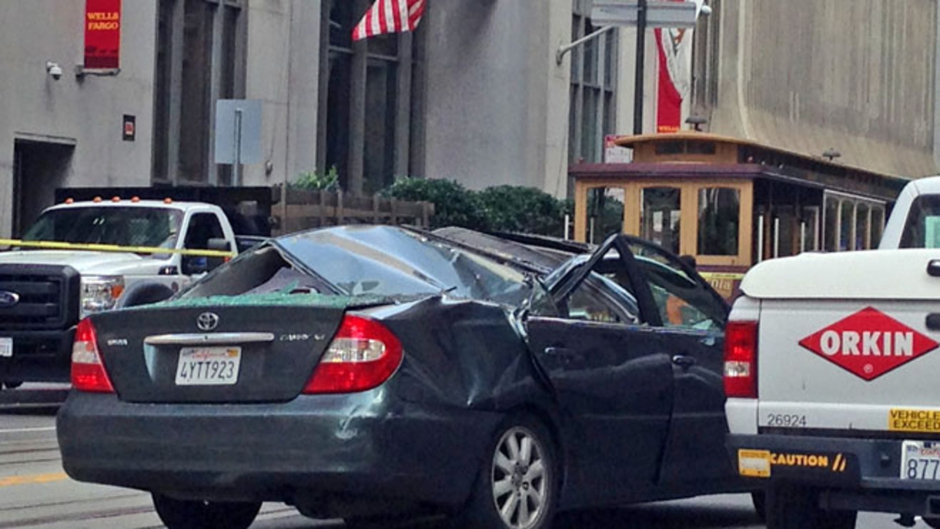 Nov. 21, 2014: A Toyota Camry has a caved in roof after a window washer fell at least 11 stories onto the moving vehicle in San Francisco. (AP)