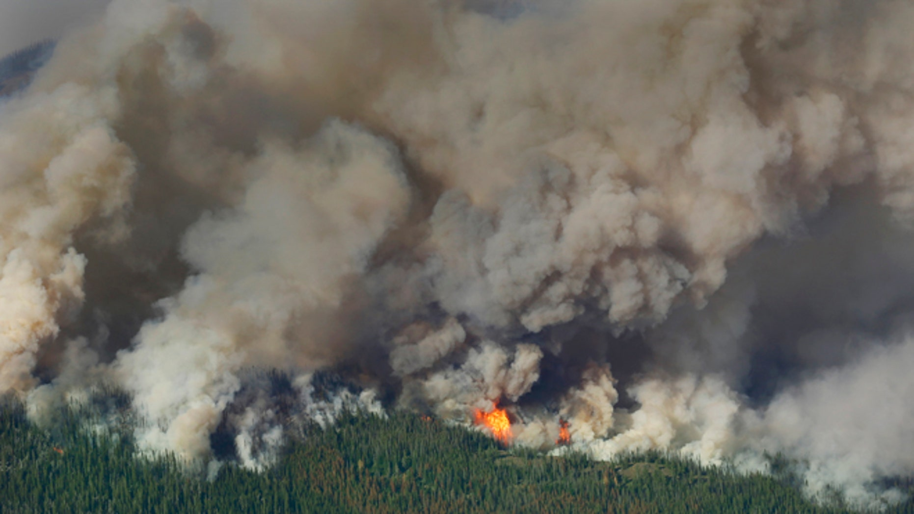 July 17, 2014: Smoke and flames rise from the Chiwaukum Creek Fire near Leavenworth, Wash.
