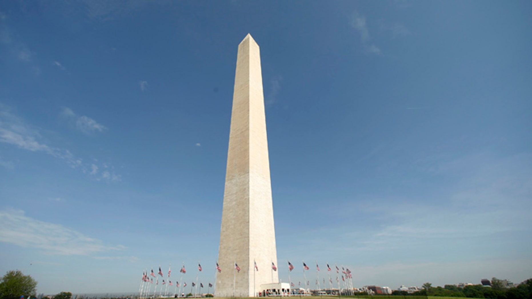 Free from its scaffolding, the Washington Monument is re-opened to the public May 12, 2014. The monument has been closed since 2011 after it suffered widespread damage caused by a 5.8 magnitude earthquake along the East Coast. REUTERS/Kevin Lamarque  (UNITED STATES - Tags: SOCIETY DISASTER) - RTR3OTS0