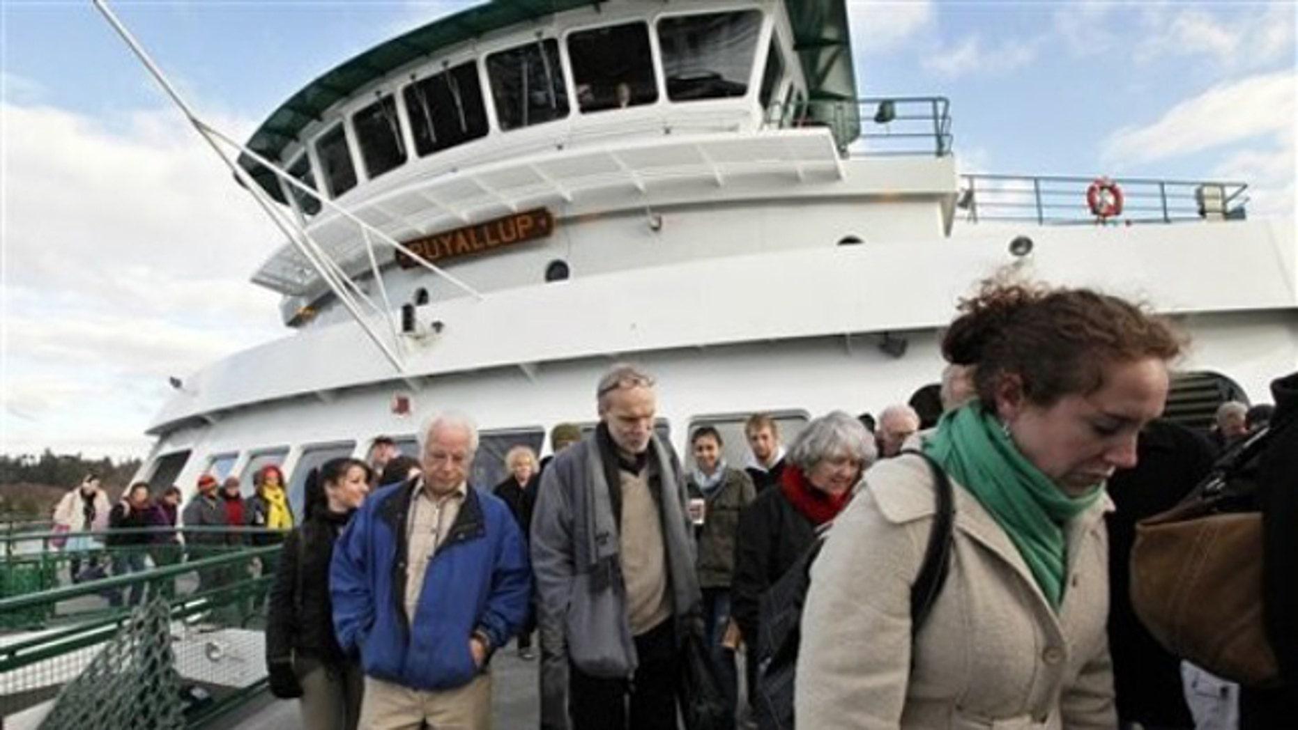 Dec. 21, 2011: Passengers disembark from the Washington state ferry Puyallup on its arrival on Bainbridge Island, Wash.