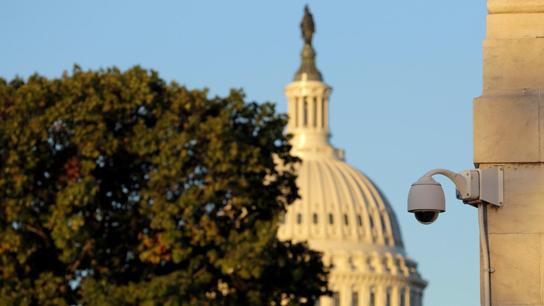 A security camera hangs near the U.S. Capitol in Washington, U.S., Nov. 7, 2016. (REUTERS/Joshua Roberts)