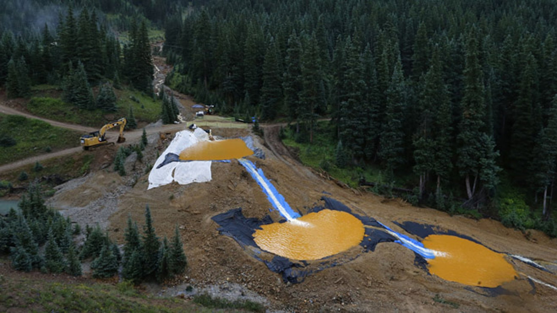 Aug. 12, 2015: Water flows through a series of retention ponds built to contain and filter out heavy metals and chemicals from the Gold King mine chemical accident, in the spillway about 1/4 mile downstream from the mine, outside Silverton, Colo. (AP)