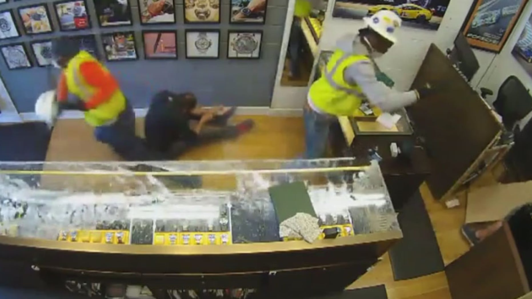 Surveillance video caught store owner Kyle O'Connor scaring intruders out of his store after he pulled out a gun.