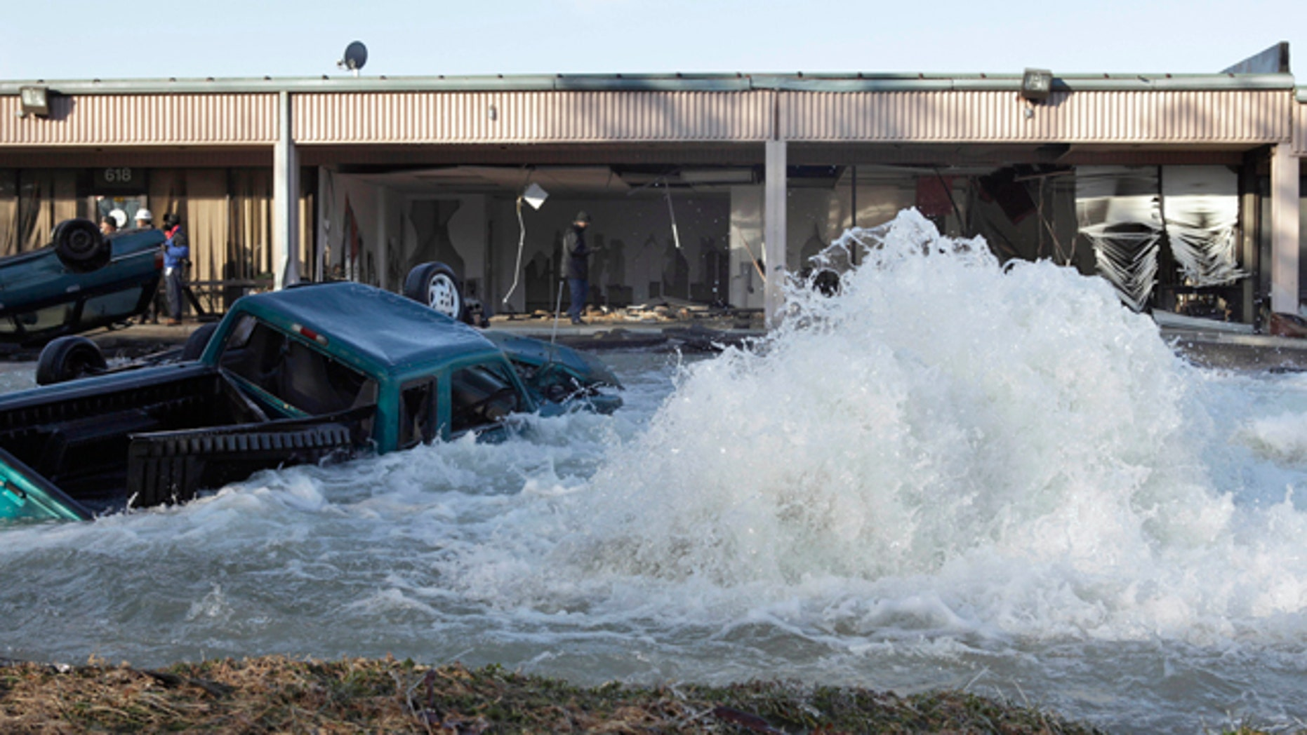 Jan. 24: A water main break is seen at an industrial park next to the Capital Beltway in Capitol Heights, Md. The break outside Washington has sent water pouring from a 54-inch pipe, prompting the closure of the inner loop of the Capital Beltway in Maryland and snarling morning traffic. (AP)